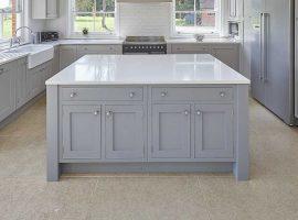 Large light grey shaker style kitchen island